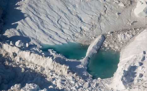 Pools of water form as ice melts atop Jakobshavn Glacier in Greenland